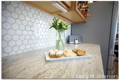 hexagon backsplash | wood cabinets | river white granite