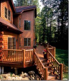 Large log house with big wrap around deck....beautiful.