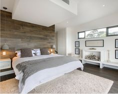 rustic meets modern bedroom : accent wall : floating nightstands : faux fireplace