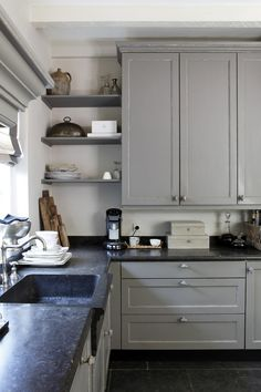 Soapstone countertop with integrated sink. Super simple cleanup, besides being a durable material for the kitchen. cupboard, open shelves, kitchen cabinet colors, sinks, grey kitchens, corner shelves, countertop, open shelving, kitchen cabinets