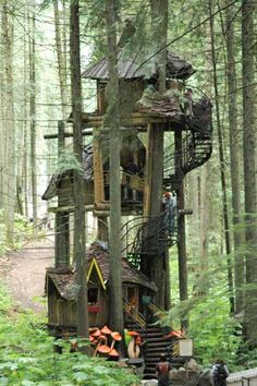 The Enchanted Forest, a family attraction built in an old growth British Columbia forest, features fairytale characters, a dragon-guarded castle, and this three-tier treehouse rising 50 feet into the air.   Photo: Wayne Krauscopf   thisoldhouse.com wooden houses, canada, old british houses, tree houses, castles, outside play houses, forest, fairytale treehouse, british columbia
