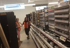 Jean and Kim tricking out the Golden aisle at BINDERS Ponce City Market store.