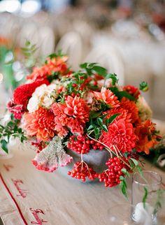 A red centerpiece with viburnum berries   Brides.com