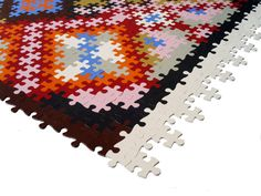 Persian rug kit made of recycled rubber puzzle pieces