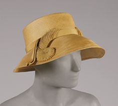 Woman's hat   United States, early 1950's   Materials: streaw, rayon grosgrain ribbon   Label: Lord  Taylor, New York   Philadelphia Museum of Art