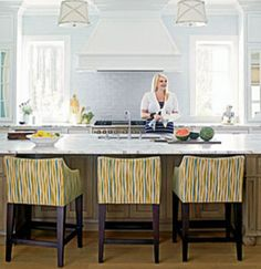 Patterned bar stools make a kitchen a sophisticated space. | coastalliving.com
