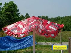 this is a dog food bag umbrella.. from fave crafts.. so clever