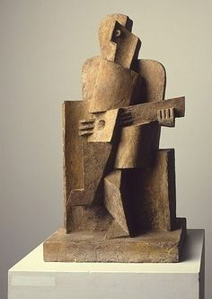Zittende man met gitaar  Seated man with a guitar  1921  Jacques Lipchitz (1891 - 1973)  plaster, paint, varnish