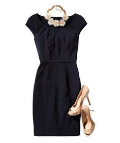 Work outfit for spring: Sheath dress with floral necklace and nude pumps.