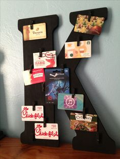 Personalized gift card tree that can be used as a memo holder. Easy project of board, hot glue, mini clothes pins and paint.