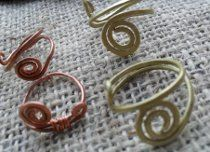 If you're looking for free wire jewelry making instructions on how to make simple wire jewelry, take a peek at these Simple Wire Ring or Ring Base instructions.