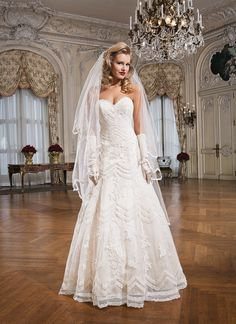 Justin Alexander wedding dress.  Soutache lace A-line dress complemented with a sweetheart neckline.