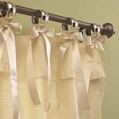 Use napkin rings and ribbons to pretty up your shower curtain. | 31 Easy DIY Upgrades That Will Make Your Home Look More Expensive