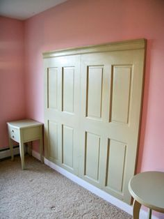Love this inexpensive idea for a headboard - 2 doors from Home Depot, painted and topped with crown molding.   I've though of using one door, turned sideways, but I think I like this better!
