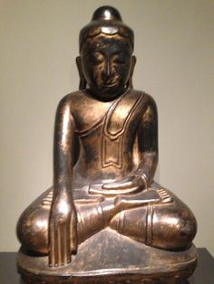 The Budda, please note the elongated ear lobes for some sweet bling.