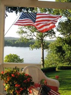 love the view....wicker...flag and lake