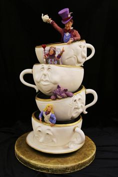 Alice in Wonderland Cake: Made by Mike's Amazing Cakes.  This Disney Cake features the Mad Hatter, the Queen of Hearts, the Cheshire Cat, & Alice, all siting in teacups / https://www.facebook.com/MikesAmazingCakes?ref=ts=ts