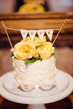 """love"" cake topper bunting, photo by BrittRene Photography http://ruffledblog.com/california-country-chic-wedding #weddingideas #weddingcake #caketoppers"