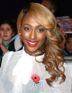 Alexandra Burke's golden, over-the-shoulder curls at the Pride Of Britain awards in London are luxuriously fabulous.