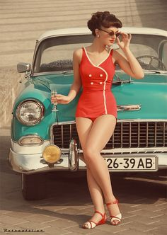 THE CAR, the bathing suit. the teal/red color combo. the hair.
