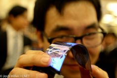 """Samsung releases Youm a thin next-generation OLED screens. The 4.5-inch screen on display was less than 0.3mm thick and sported an impressive WVGA (800x480 pixel) resolution that can be curved. Samsung claims it is """"unbreakable.""""  via CNET http://cnet.co/HqoAPa #material #screen"""