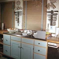Julia Child's Kitchen... Julia hung magnetic knife racks between the windows to use every inch of storage space