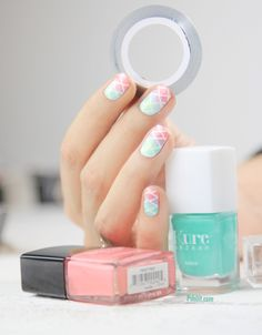 Squarred Gradient nail art. Paint in white. Once dried, add tape lines. Then use a sponge to apply the ombre colors. There's a animated gif to show how it's done.