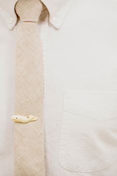 whale tie clip, photo by Photo by Betsy http://ruffledblog.com/austin-spring-wedding-inspiration #groom #tieclips