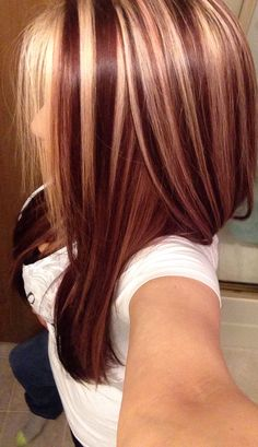 Auburn hair with blonde highlights, just add some dark chocolate in there and it's perfect