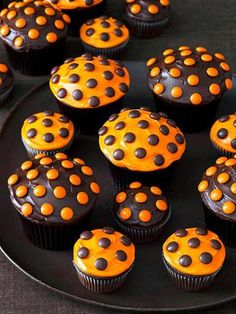 Halloween Polka Dot Cupcakes - super easy choc frosting w/ orange reeses pieces and orange frosting with the brown pieces, adorable