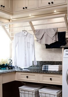 Laundry room pull out clothing drying rack