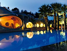 Palais Bulles, designed by architect Antti Lovag for Pierre Cardin. A pool at night.