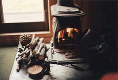 Fireside is best. wood burning stoves, winter, little houses, fireplaces, cabins, zombie apocalypse, cozy spaces, log, wood stoves