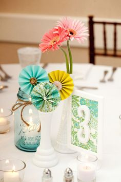 Vintage wallpaper flowers and gerbera daisies. Love the wallpaper table numbers too!