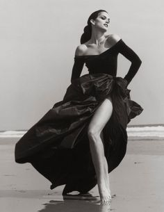 Cindy Crawford, Ferre 3, Malibu, 1993 by Herb Ritts.  Supermodel Cindy Crawford (whom Ritts introduced to her first husband, Richard Gere) on the beach in Malibu, California.