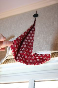Tailored valance with contrast fabric in pleat.