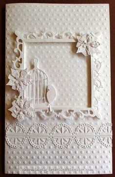 White monochrome card using spellbinder and memory box dies