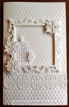 White monochrome card using spellbinder and memory box dies