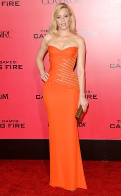 Elizabeth Banks accentuates her curves in an orange Versace number. Love it! #fashion
