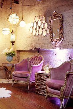 rustic walls w purple velvet chairs