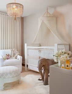 The light color scheme and canopy above the crib are great. I think I'd incorporate a fabric for the canopy that had a little more sparkle, so that the light from the window and chandelier would catch it.