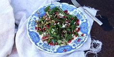 Spring asparagus and rocket salad with goat's cheese and pomegranate.