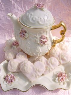 Pretty tea pot and sugar cookies.