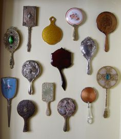 i still plan on an entire wall at home...love hand mirrors