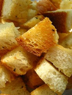 Garlic Croutons  Preheat the oven to 350F. Take day old bread and cut into one-inch cubes. Toss with a few glugs of olive oil, salt, pepper, and garlic powder. Arrange in a single layer on a jellyroll pan covered in foil. Toast for about 10 minutes or until golden. Allow to cool. Serve or store in an airtight container for up to a week.