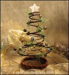 "Rusty Prim ""Bed Spring"" Christmas Tree...perfect tree shape."