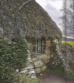 window on a thatched roof cottage