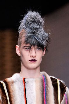 The Faux-hawk. A straight tight braid and an attached accessory in a nod to punk, at Fendi.