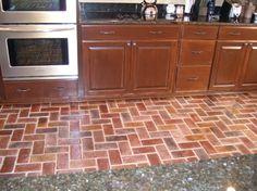 Brick flooring in kitchen.