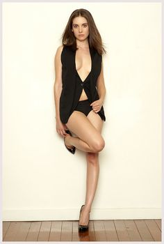 Alison Brie gorgeous cleavage and sexy legs in an open black top and high heels